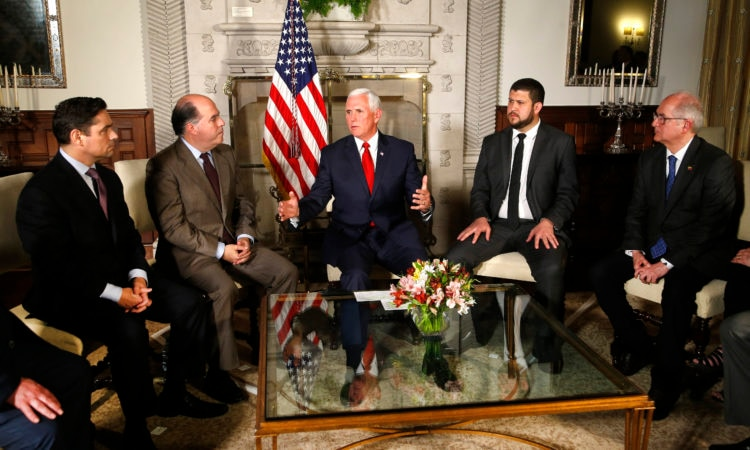 U.S. Vice President Mike Pence, center, speaks with Venezuelan opposition leaders Carlos Vecchio, left, Julio Borges, David Smolansky and Antonio Ledezma during a meeting at the residence of the US ambassador, in Lima, Peru, Friday, April 13, 2018. (AP Photo/Karel Navarro)