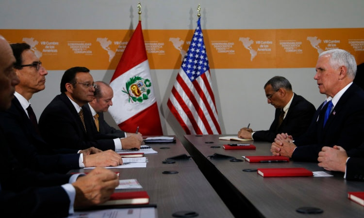 U.S. Vice President Mike Pence, right, meets Peru's President Martin Vizcarra, left, during a bilateral meeting at the Summit of the Americas in Lima, Peru, Saturday, April 14, 2018. (AP Photo/Karel Navarro)