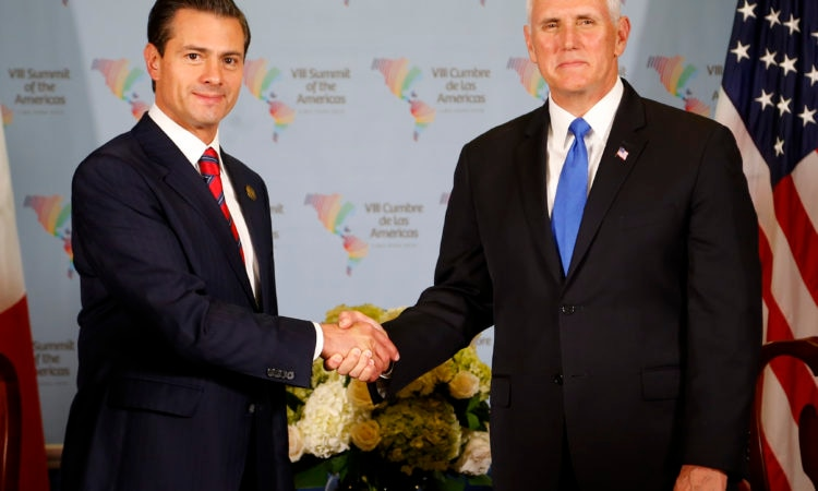 U.S. Vice President Mike Pence, right, shakes hands with Mexico's President Enrique Pena Nieto during a bilateral meeting at the Summit of the Americas in Lima, Peru, Saturday, April 14, 2018. (AP Photo/Karel Navarro)