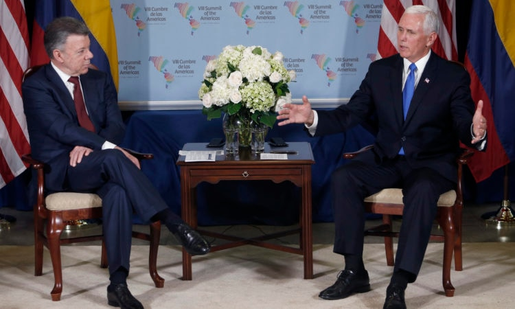 U.S. Vice President Mike Pence, right, meets Colombia's President Juan Manuel Santos during a bilateral meeting at the Summit of the Americas in Lima, Peru, Saturday, April 14, 2018. (AP Photo/Karel Navarro)