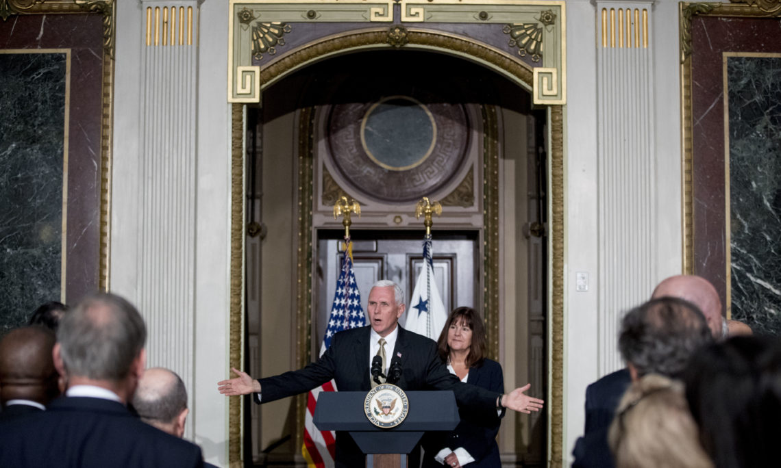 Vice President Mike Pence, accompanied by his wife Karen Pence, right, speaks at a reception for the Organization of American States in the Indian Treaty Room at the Eisenhower Executive Office Building on the White House complex in Washington, Monday, June 4, 2018 (AP Photo/Andrew Harnik)